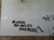 A graffiti painted on a white wall, Lisbon. Photo by Maria Concetta Lo Bosco, 2016